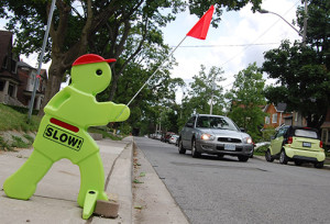 SLOW DOWN: Residents have put up caution signs on Leaside streets since a tragic accident on July 16 claimed the life of a 6-year-old girl. Police announced charges today against the driver of a minivan involved in the accident.