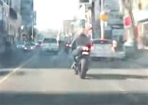 TRACKED: Video from a dashboard camera shows motorcycles weaving through traffic on Yonge Street before crash.