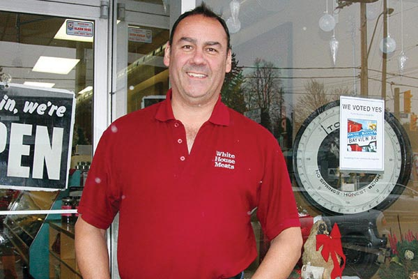 IN FAVOUR: Bayview Avenue business owner Stanley Janecek stands in front of his store, with a sign supporting the proposed Bayview Leaside BIA.