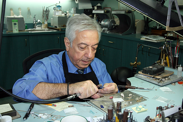 Varouj Tabakian crafts a ring in his Eglinton West jewellery store.
