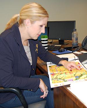 Christin Carmichael Greb with map of Bannockburn School greenspace.