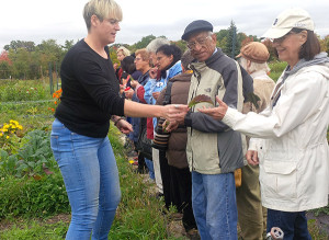 FRESH FROM THE FARMER: Seniors visit Fresh City Farms in North York on an outing organized by People and Organizations in North Toronto. Farmer