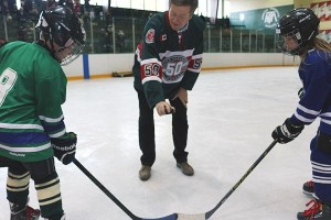 THE OPENING FACEOFF: Toronto mayor John Tory drops the puck for Bradley Hotson, left, and Isabella Rispoli.