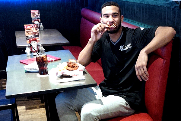 STEALING A MOMENT: Toronto Raptors point guard Cory Joseph takes time to  savour the wings at the St. Louis Bar and Grill on Yonge Street at Lola Road. With  NBA All-Star weekend coming to the city, the restaurant has partnered with the  Canadian baller to celebrate hoops and food.