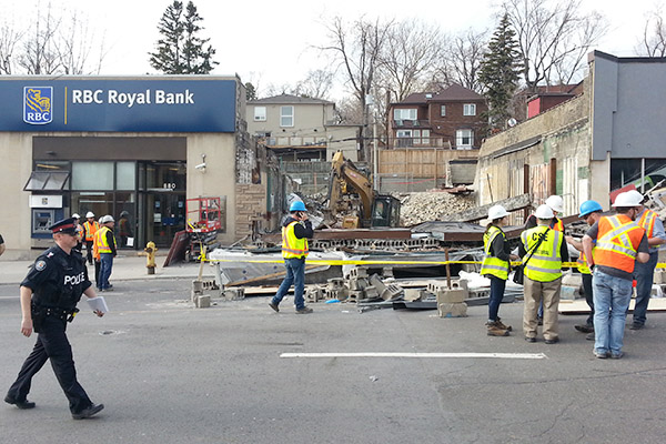 RUBBLE: Several people were sent to hospital with unknown injuries after the building on this site collapsed on Monday afternoon. Witnesses are reported to have said a crane at the construction site fell, knocking down scaffolding and remaining building walls. Eglinton was blocked in both directions as fire and other emergency staff worked to pull people from the wreckage.