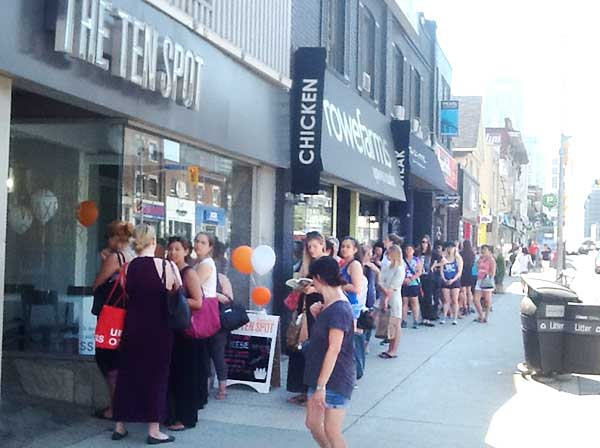 SEEKING FAST 'CURES: The lineup snaked down Yonge Street on Aug. 10 outside The Ten Spot. Like other franchises in Toronto, the location near Keewatin Avenue offered free quickie manicures, pedicures and waxes to celebrate the company's 10th anniversary.