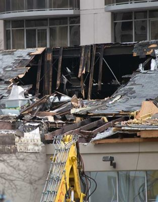 Roof burned through in racquet club fire.