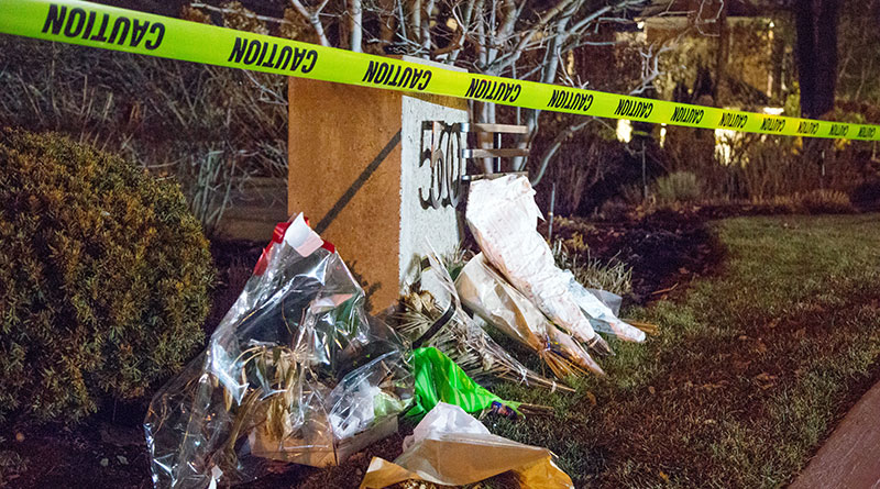 roadsicde tribute at double homicide house