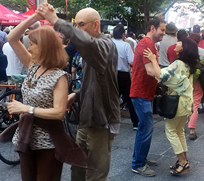 Couples dancing to Downchild at jazz festival