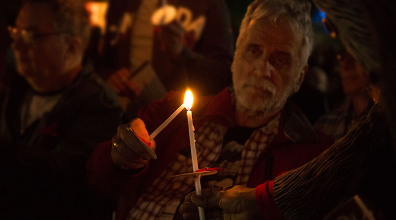 Candlelight vigil passes on the flame