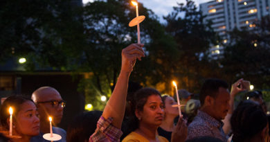 candle held high for 650 Parliament St. homes