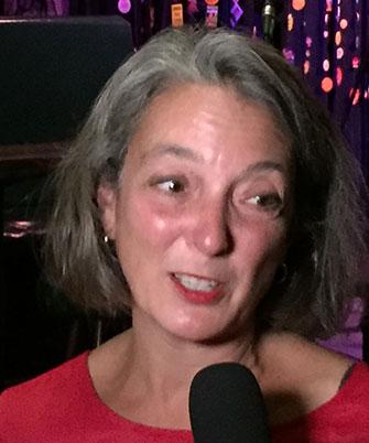 Julie Dabrusin being interviewd