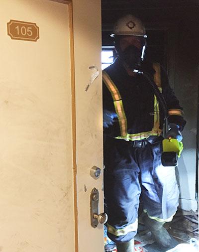 investigator at apartment fire