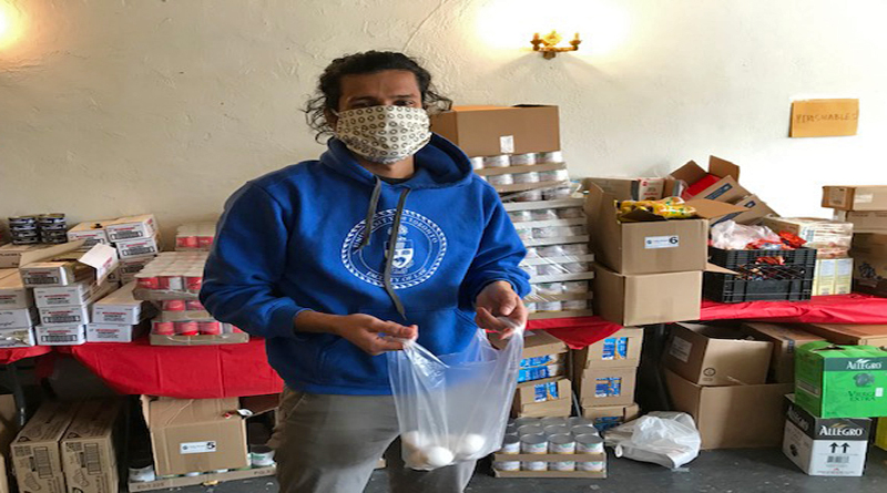 This image shows a volunteer participating in the food bank operations.