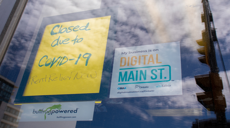"""This image shows a sign that says """"Closed due to COVID-19."""""""