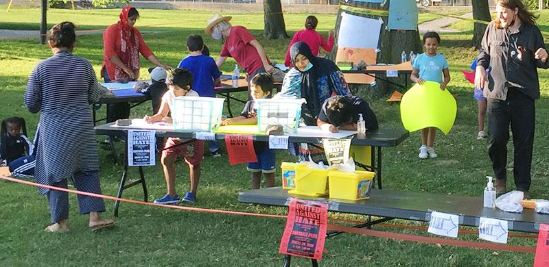 Kids making signs in Dentonia Park