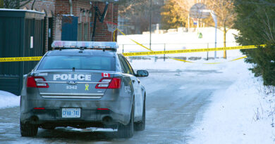 police car in laneway where shooting took place